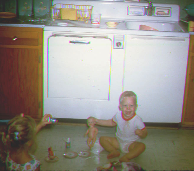 Randy at 18 months playing with Mary's doll.
